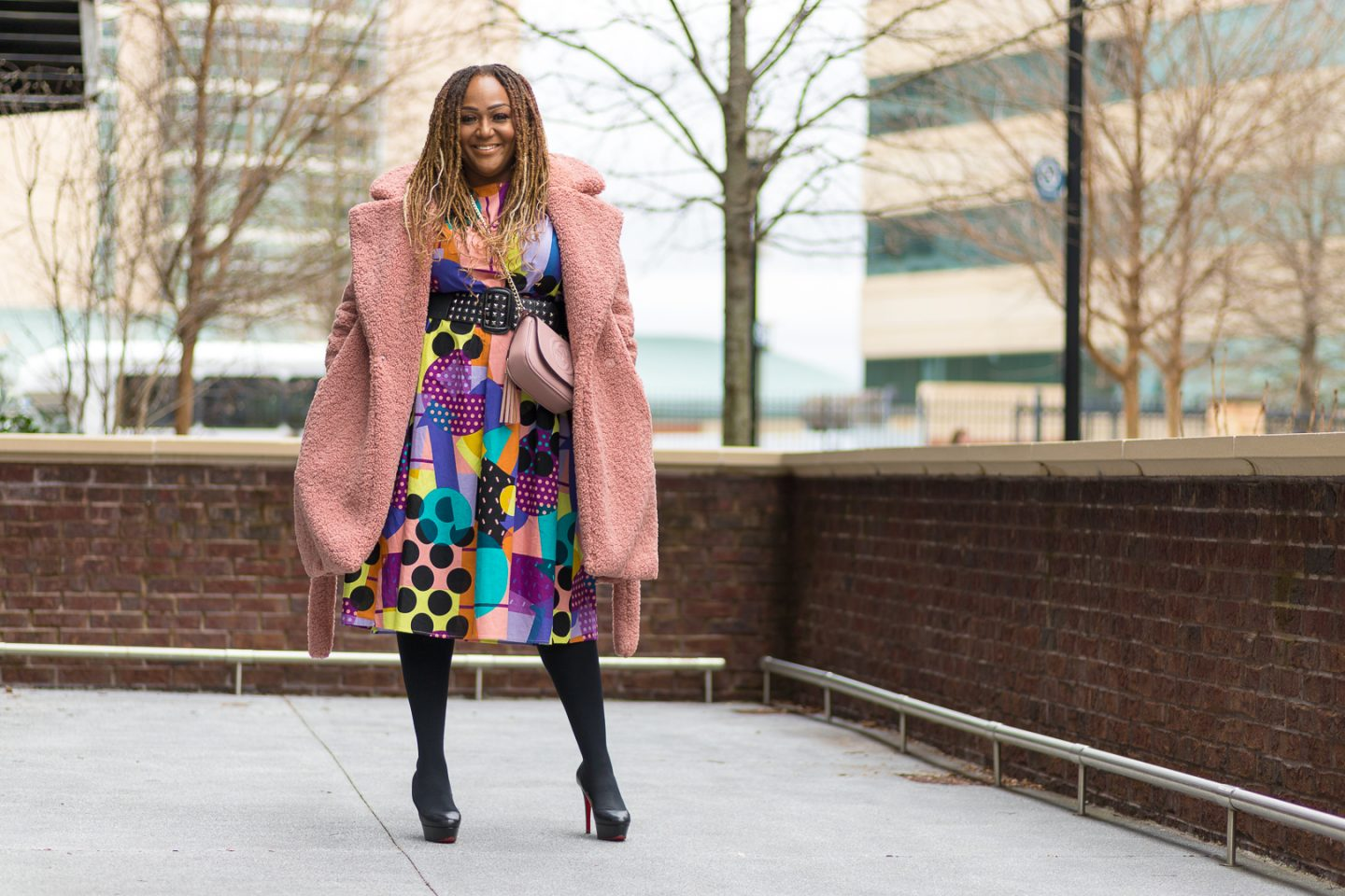 Influencer Nikki Free wearing colorful print dress from SHEIN with Teddy Coat