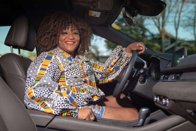 Influencer Nikki Free sits inside the Mazda6 Signature
