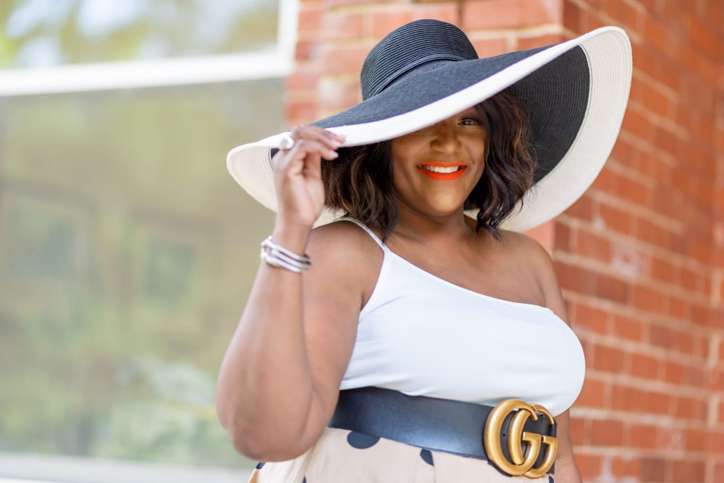 Blogger Nikki Free wearing wide brim black and white sunhat
