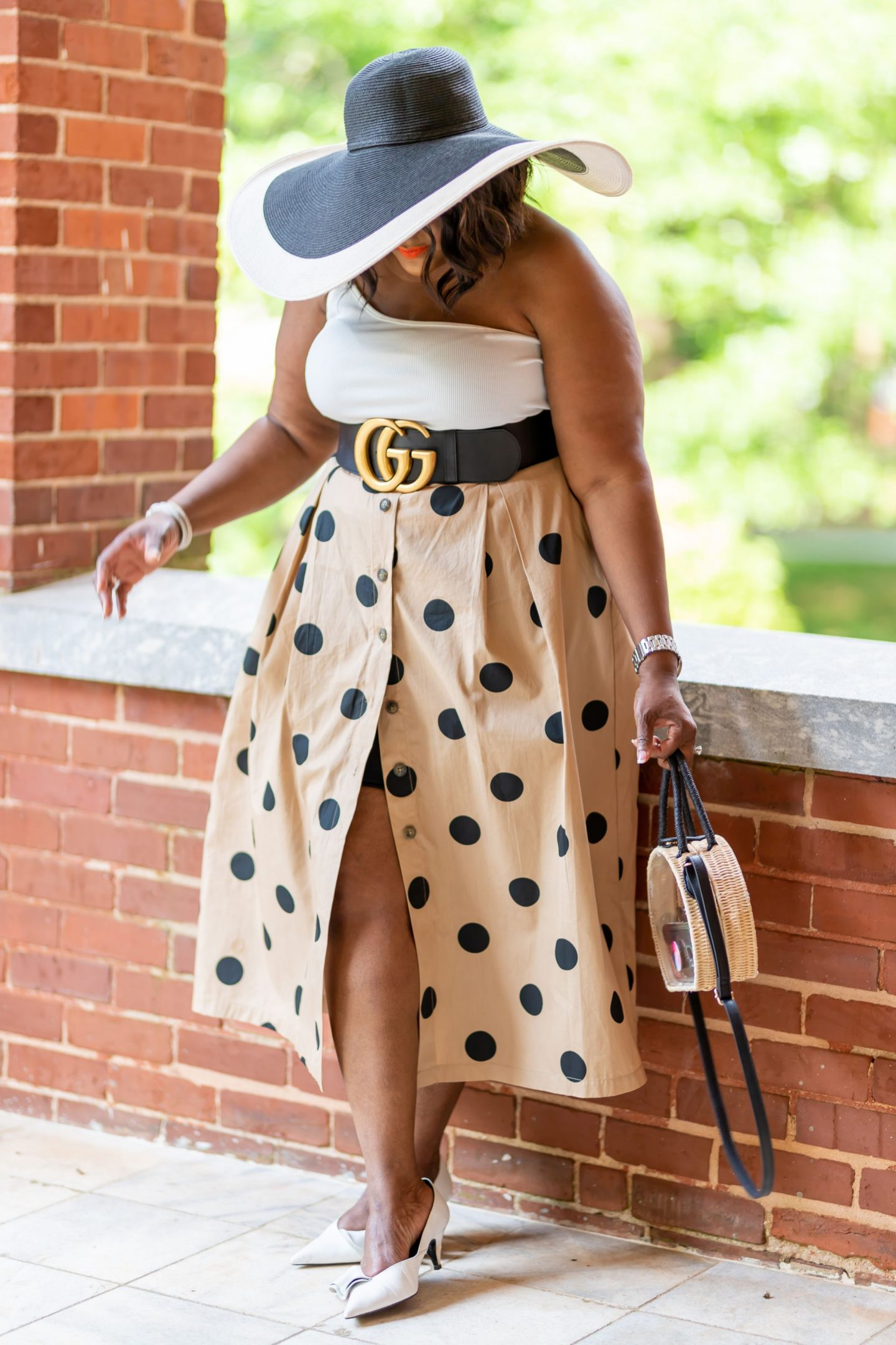 Blogger Nikki Free wearing khaki skirt with black polka dot print from Target