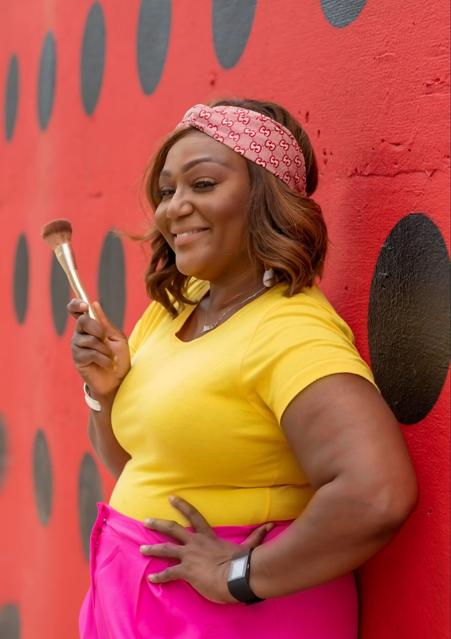 Influencer Nikki Free holding angled makeup brush