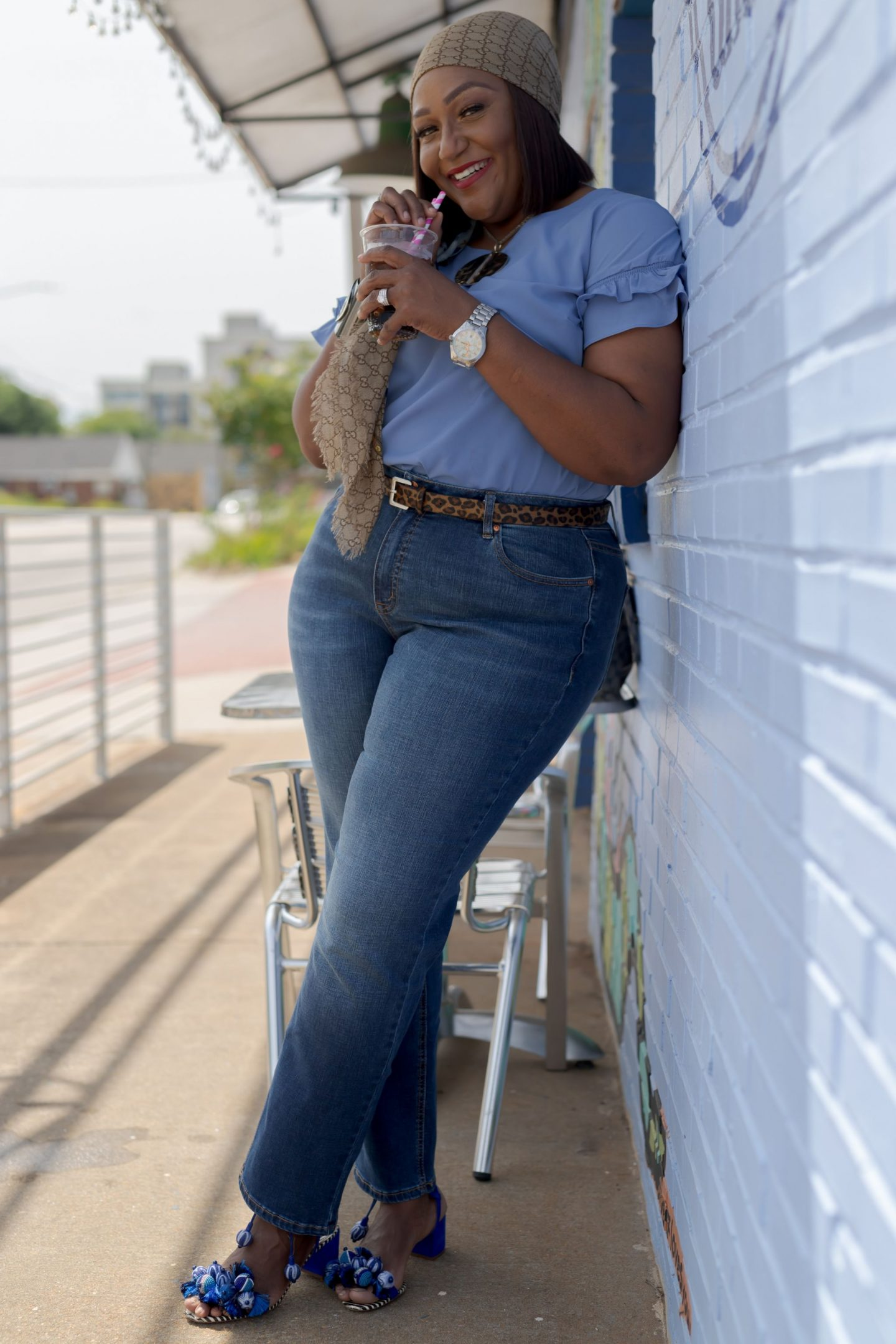 Influencer Nikki Free leaning on a wall wearing Lane Bryant Flex Magic Waistband Jean