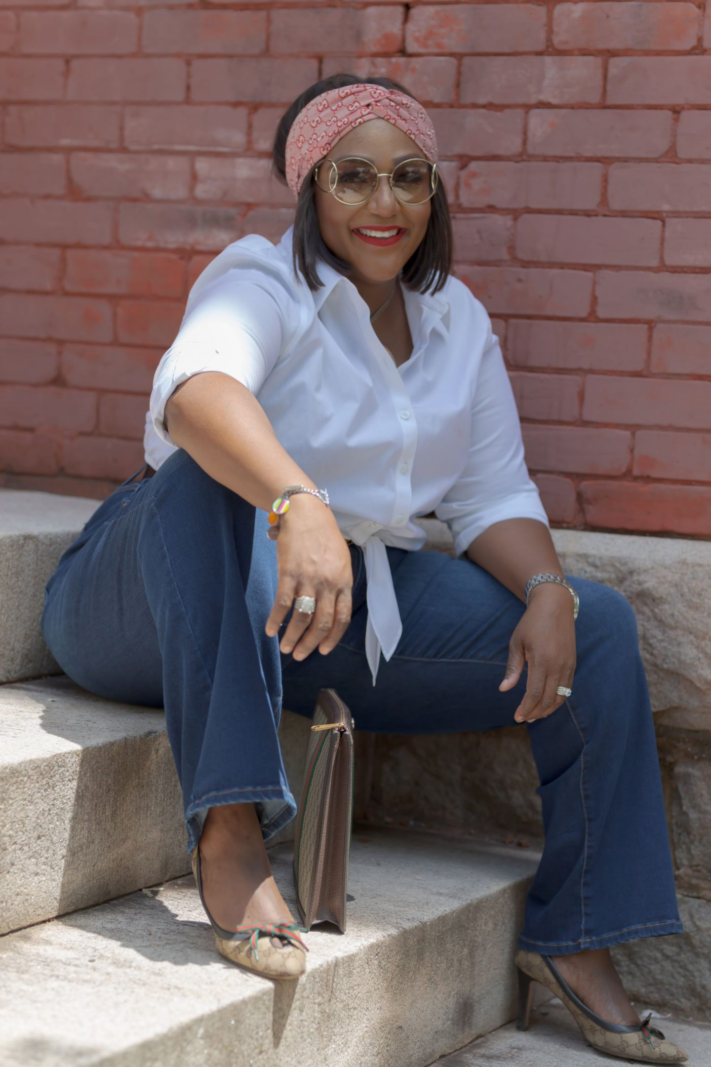 Influencer Nikki Free sitting on stairs wearing Lane Bryant Flex Magic Waistband Jean
