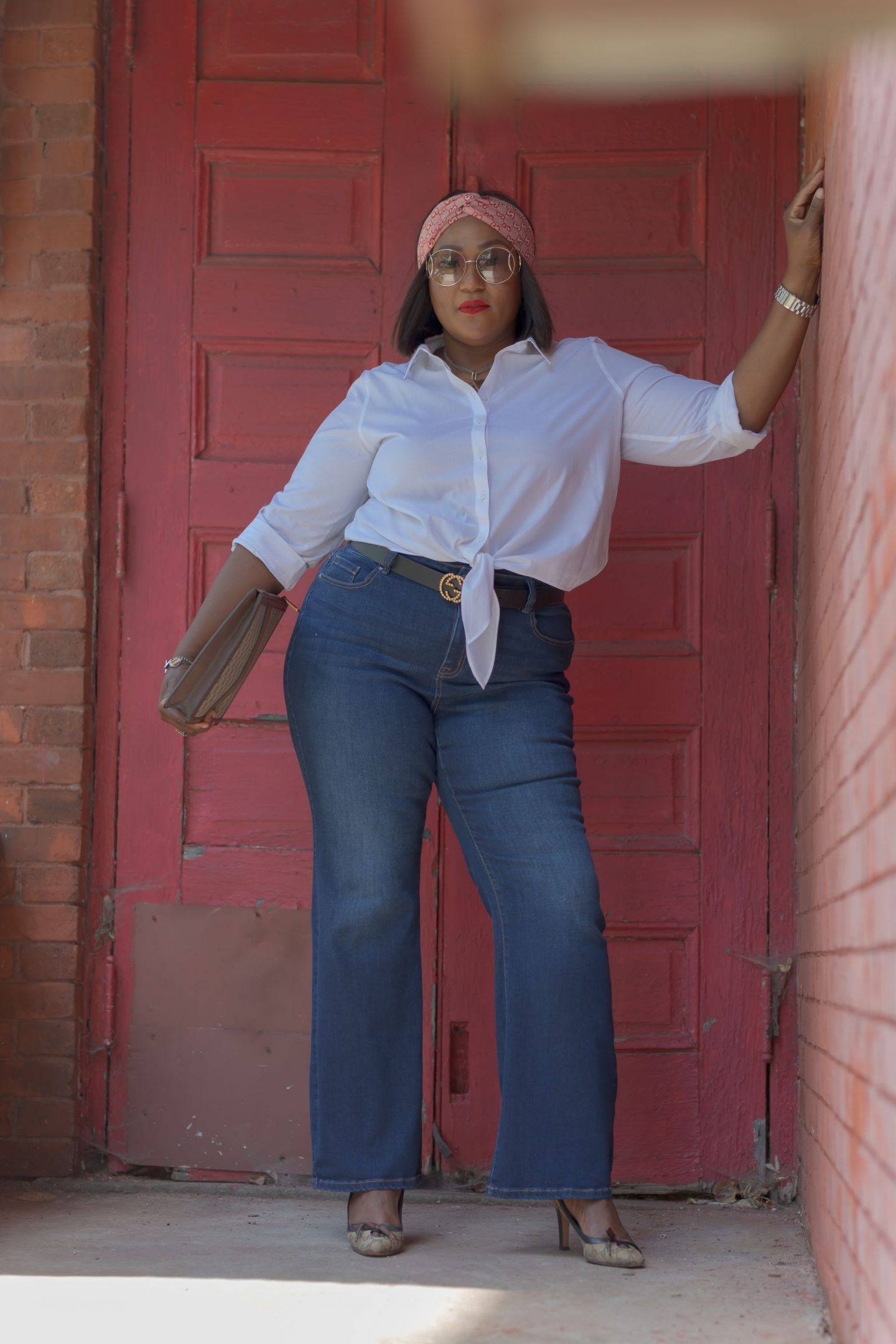 Influencer Nikki Free leaning on wall wearing Lane Bryant Flex Magic Waistband Jean