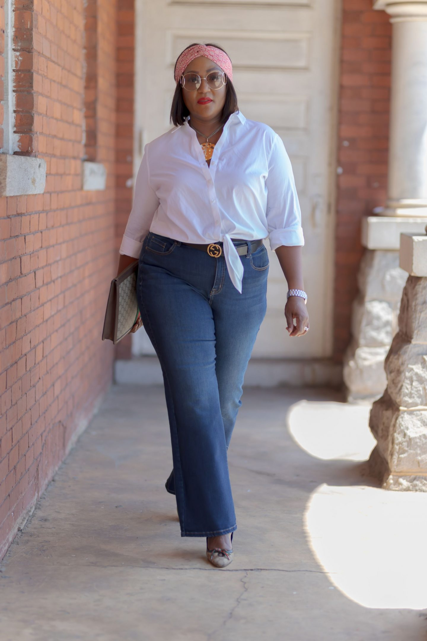 Influencer Nikki Free walking in pair of Lane Bryant Flex Magic Waistband Jean