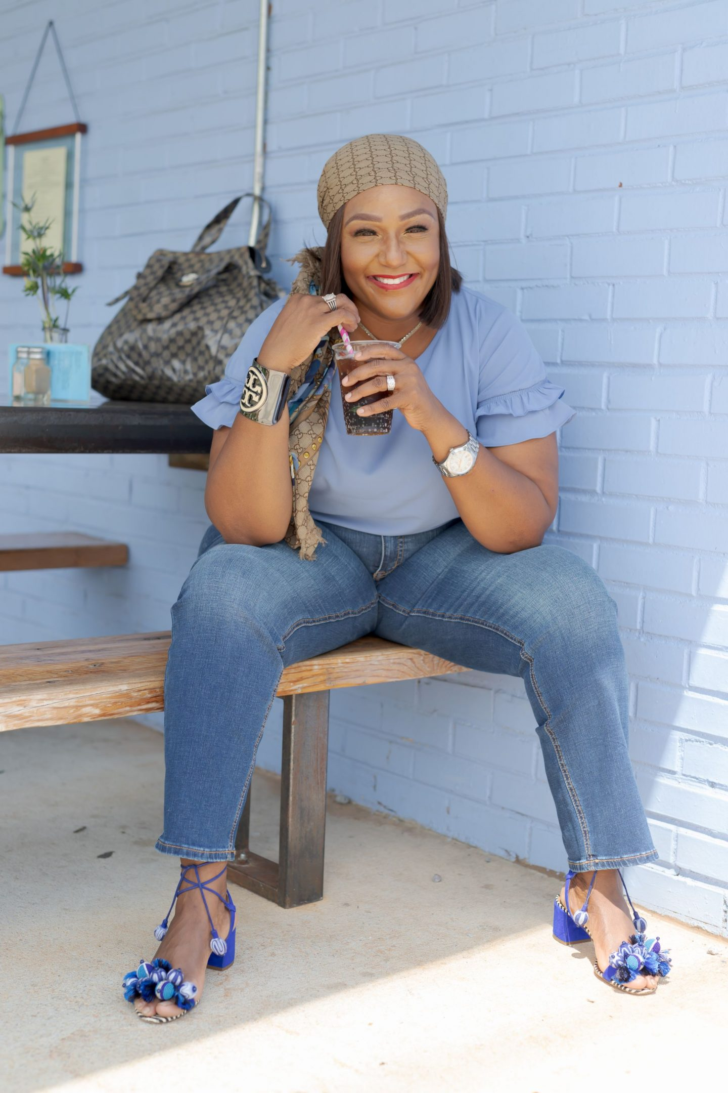 Influencer Nikki Free sitting on bench wearing Lane Bryant Flex Magic Waistband Jean
