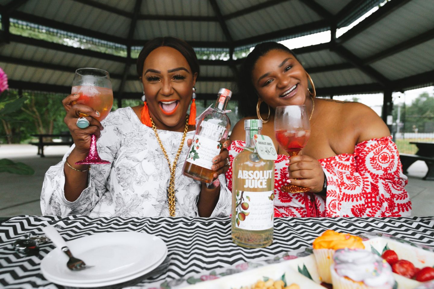 two black women at a table drinking Absolut Juice