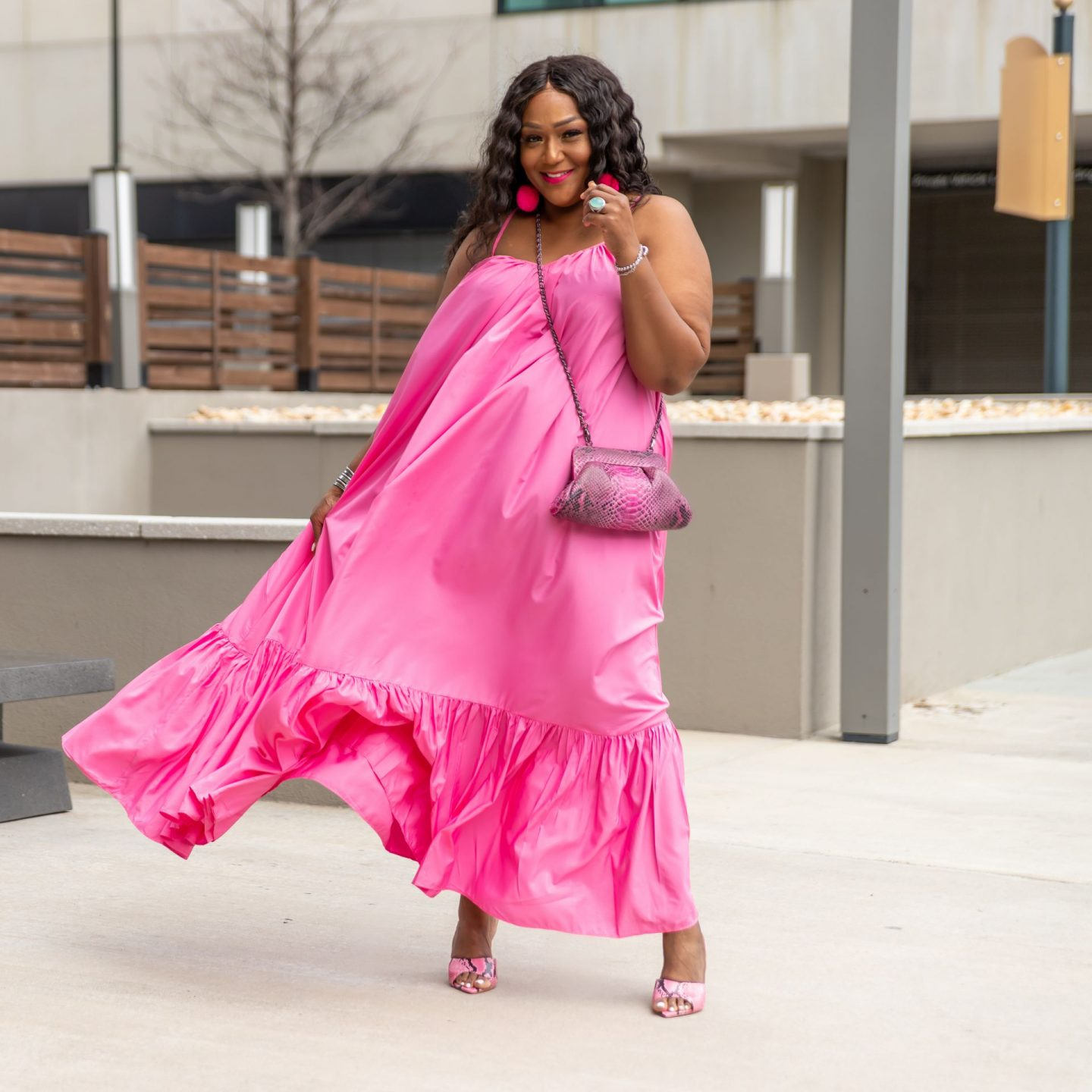 Blogger Nikki Free in flowing pink maxi sundress