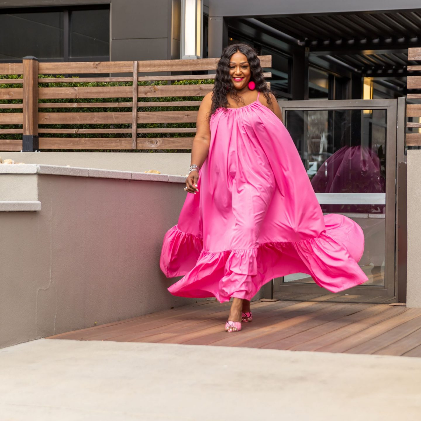 Black woman in flowing pink maxi sundress