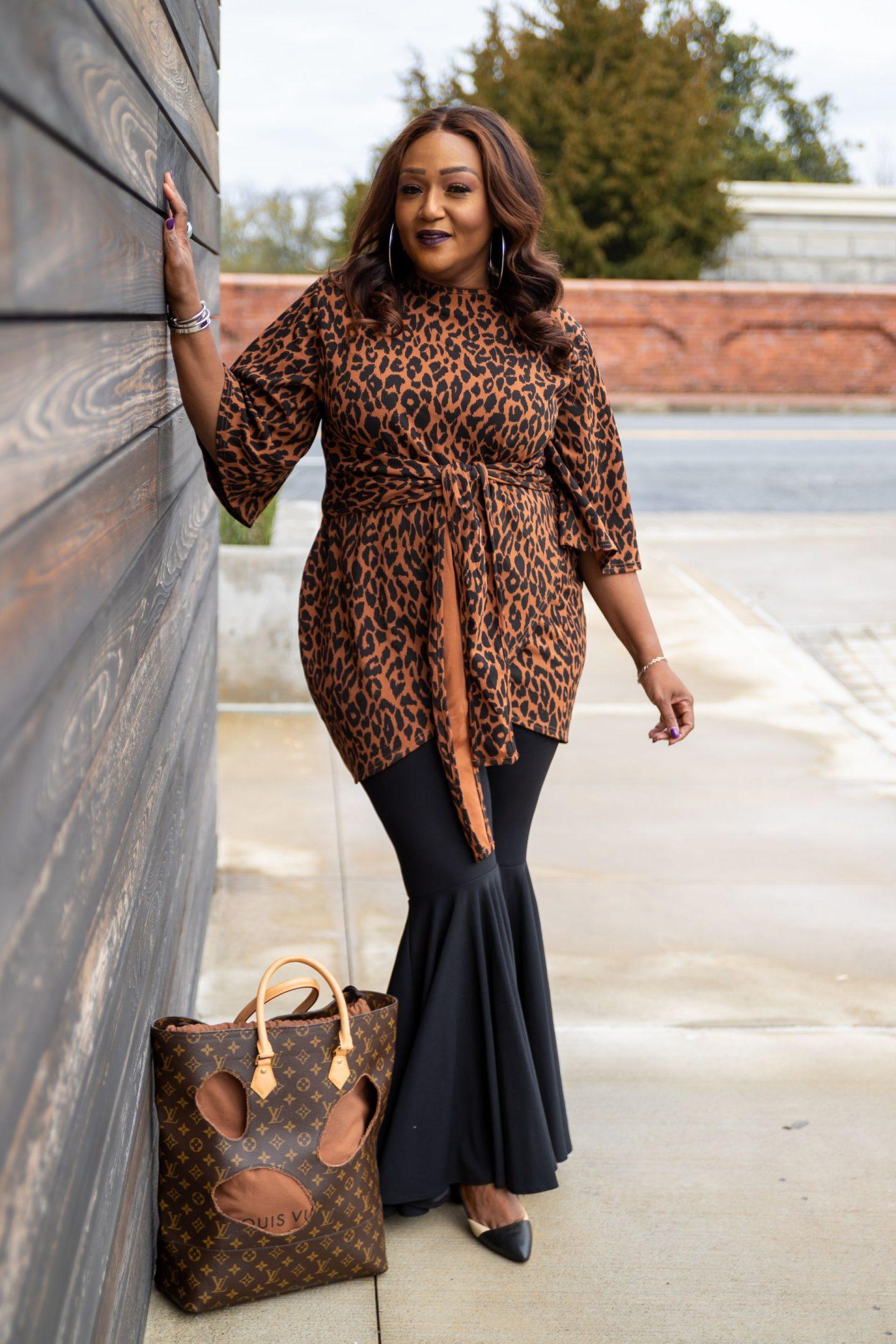Influencer Nikki Free wearing leopard print top over Wacoal bra