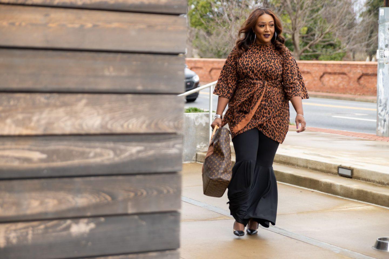 Influencer Nikki Free walking and wearing leopard print top over Wacoal bra