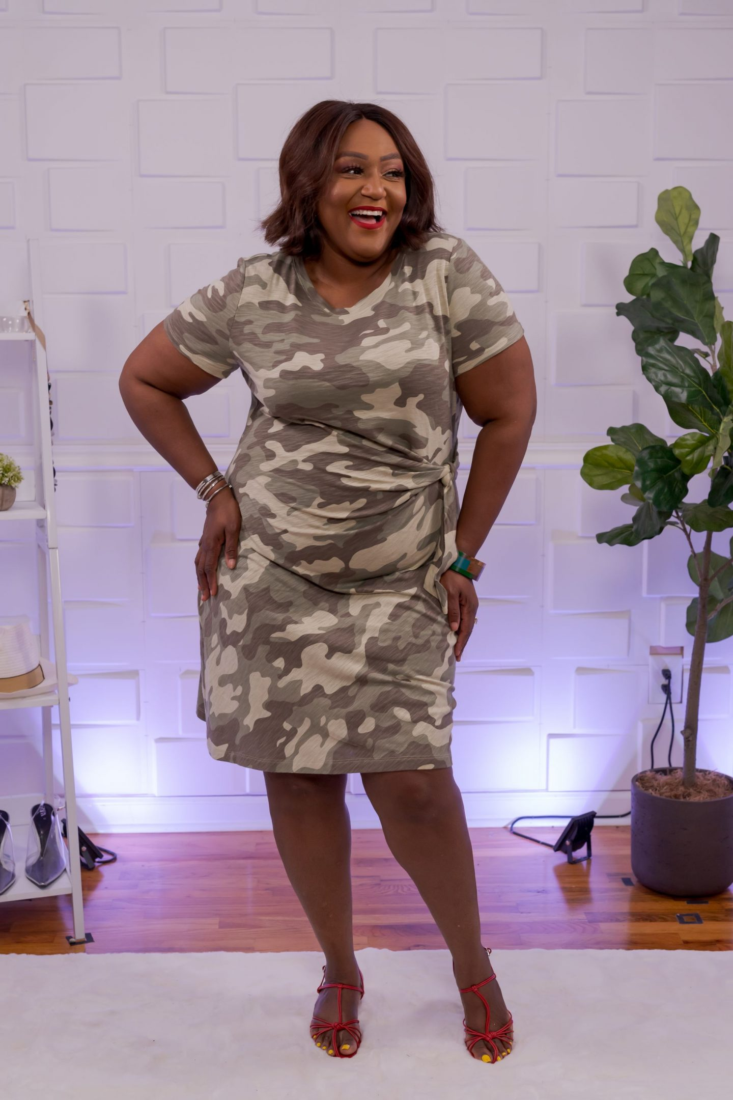 Nikki Free wearing a camouflage t-shirt dress
